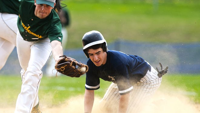 BFA's Kyle Cioffi (4) lunges to catch the ball thrown by the catcher as Burlington's Chris Fenimore (11) slides safely into second base during the boys baseball game between BFA St. Albans and Burlington at Burlington high school on Saturday afternoon May 9, 2015 in Burlington.