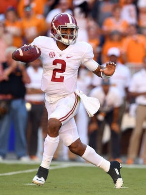 Alabama Crimson Tide quarterback Jalen Hurts (2) drops back to pass under pressure from the Tennessee Volunteers defense during the first quarter at Neyland Stadium.