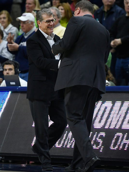 Connecticut head coach Geno Auriemma shakes hands with Saint Francis (Pa.) head coach Joe Haigh, right, at the end of a first-round game in the NCAA women's college basketball tournament in in Storrs, Conn., Saturday, March 17, 2018. UConn won 140-52. (AP Photo/Jessica Hill)