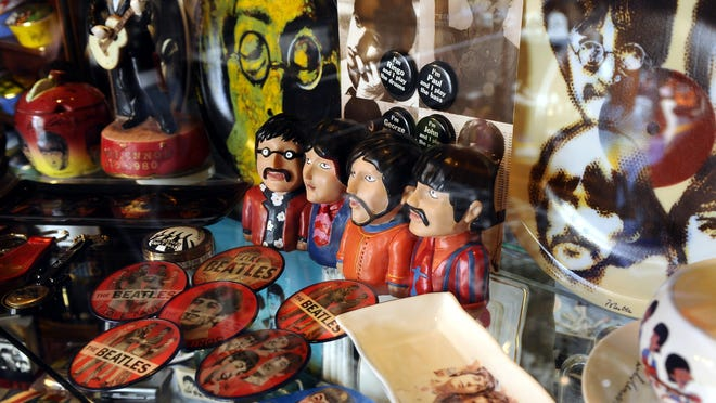 Figurines, buttons, porcelain, items are just a few items in the Beatles memorabilia collection owned by Victoria Spector-Walker and Jim Walker.