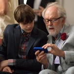 """This image released by Sony Pictures Classics shows Charlie Tahan , left, and John Lithgow in a scene from """"Love Is Strange."""""""