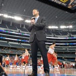 Andy Katz, senior college basketball reporter with ESPN does a stand up during Wisconsin's practice before a Final Four game last April.