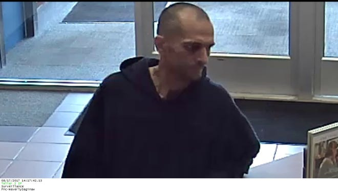This surveillance video image was captured during a robbery at the PNC Bank banch at W. Saginaw St. and Waverly Rd. on Thursday, Aug. 17, 2017.