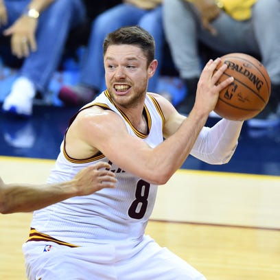 Matthew Dellavedova handles the ball against Golden State Warriors guard Stephen Curry in game four of the NBA Finals.
