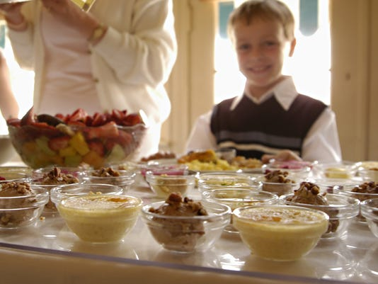2004/04/11. CIN. BRUNCH. Carter Jackson of West Chester, age 5 1/2, is all smiles as he spies dessert at Easter brunch at the Grand Finale. Photo by Malinda Hartong for Cin.