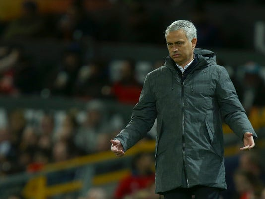 Manchester United's manager Jose Mourinho holds his arms out as he watches during the Europa League quarterfinal second leg soccer match between Manchester United and Anderlecht at Old Trafford stadium, in Manchester, England, Thursday, April 20, 2017. (AP Photo/Dave Thompson)