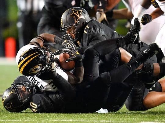 Missouri running back Larry Rountree III (33) is tackled by Vanderbilt linebacker Jordan Griffin (40) and defensive tackle Nifae Lealao (77) during the first half at Vanderbilt Stadium in Nashville, Tenn., Saturday, Nov. 18, 2017.