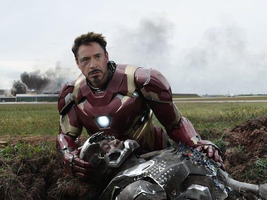 Tony Stark (Robert Downey Jr.) protects a downed War