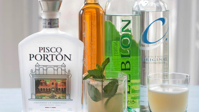 From left to right, Pisco Portion, Leblon special reserve, a cachaca mojito made with Leblon cachaca, Leblon cachaca, Control original pisco premium and a pisco sour.