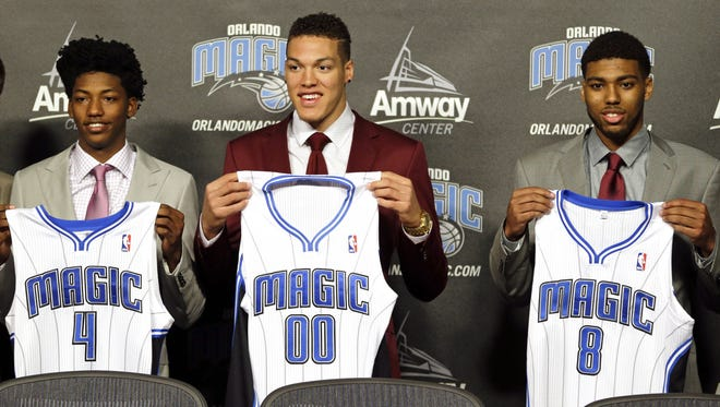Orlando's draft picks Elfrid Payton (4), Aaron Gordon (00) and Roy Devyn Marble (8) attend a news conference introducing them Friday in Orlando.