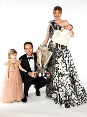 Jimmie Johnson, his wife Chandra, daughters Genevieve Marie, left, and  Lydia Norriss pose for a portrait prior to the NASCAR Sprint Cup Series Champion's Awards at the Wynn Las Vegas on Dec. 6.