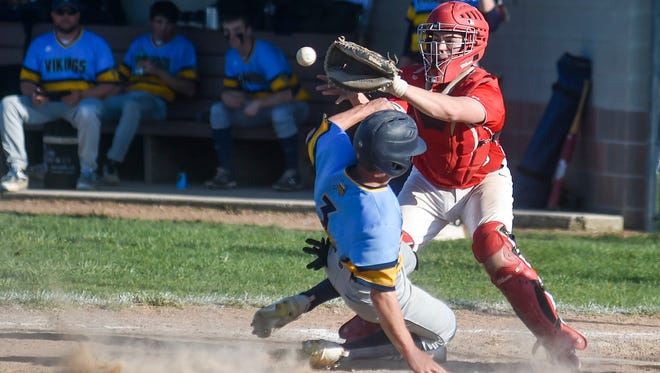 River Valley's Karac Doubikin races to beat the throw to home during the River Valley at Pleasant baseball game last week.
