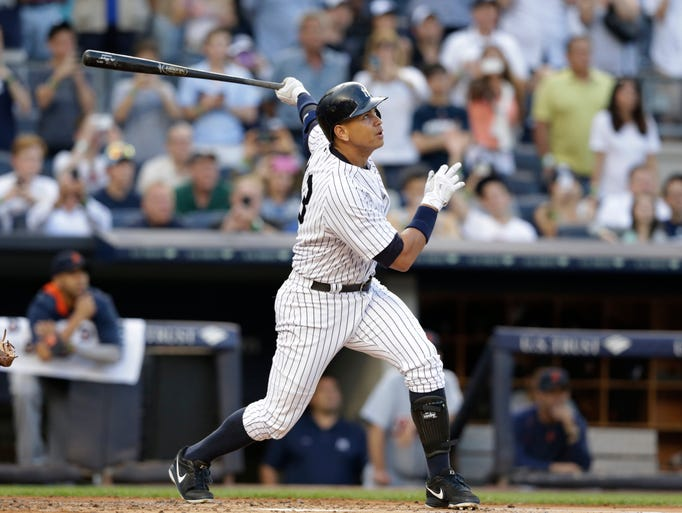 New York Yankees' Alex Rodriguez hits a home run for