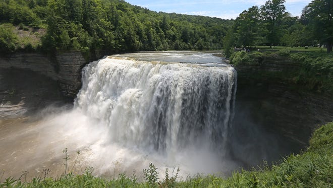 Waters of the Genesee River pour over the iconic Middle Falls in the South End at Letchworth State Park.