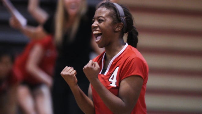 Leon senior Daijah Washington celebrates scoring the match-winning point on an ace in Tuesday's regional quarterfinal playoff game between Leon and Tate.