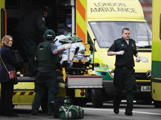 A member of the public is moved into an ambulance by emergency services near Westminster Bridge and the Houses of Parliament on March 22, 2017, in London, England. A police officer has been stabbed near to the British Parliament and the alleged assailant shot by armed police. Scotland Yard report they have been called to an incident on Westminster Bridge where several people have been injured by a car.