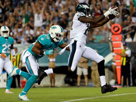 Philadelphia Eagles' Alshon Jeffery, right, scores a touchdown past Miami Dolphins' Nate Allen during the first half of a preseason NFL football game, Thursday, Aug. 24, 2017, in Philadelphia. (AP Photo/Michael Perez)