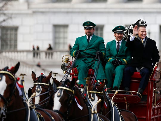 Missouri Gov. Eric Greitens ride on a wagon pulled by the Budweiser Clydesdales after his inauguration ceremony at the Missouri State Capital on Monday, Jan. 9, 2017.