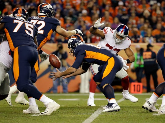 Denver Broncos quarterback Trevor Siemian regains the football after bobbling it during the first half of an NFL football game against the New York Giants, Sunday, Oct. 15, 2017, in Denver. (AP Photo/Jack Dempsey)