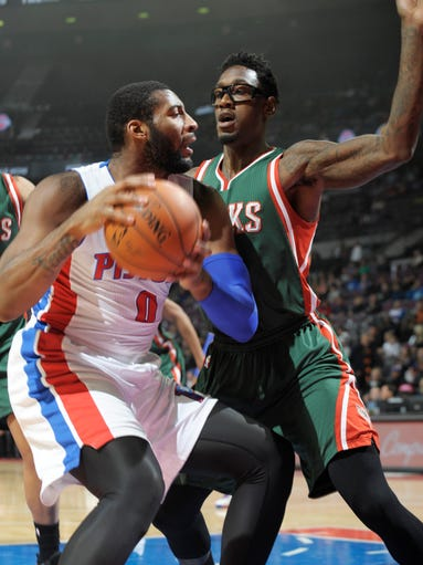 Pistons' Andre Drummond looks for room around the Bucks'