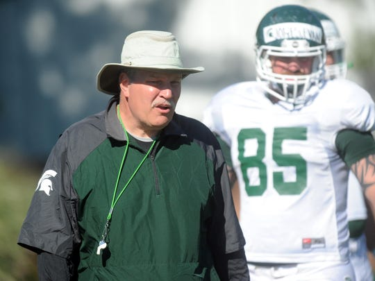 MSU coach Jim Bollman works with the tight ends during practice Wednesday. Photo taken 8/14/2013 by Greg DeRuiter/LSJ
