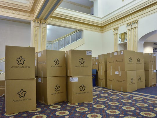 Boxes line the lobby at the Paramount Theatre Thursday as the new theater seats are installed.