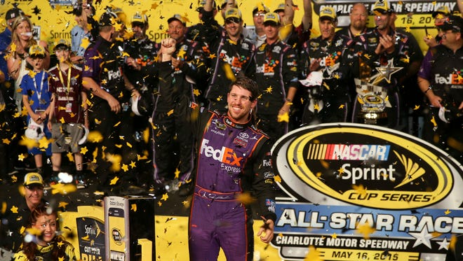 Denny Hamlin and the No. 11 Joe Gibbs Racing crew celebrate after winning the NASCAR Sprint All-Star Race at Charlotte Motor Speedway.
