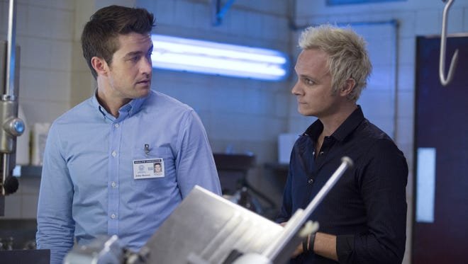 Major Lilywhite (Robert Buckley), left,  is beginning to suspect that something's not quite right about Blaine  DeBeers (David Anders) and his deli  on the CW's 'iZombie.'