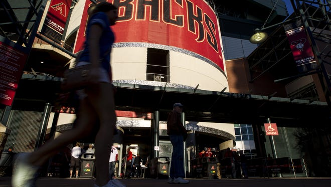 Fans enter the stadium before the Arizona Diamondbacks' game against the Kansas City Royals on Friday, Apr. 1, 2016 at Chase Field in Phoenix.