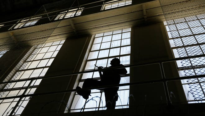 A guard keeps watch on the east block of death row at San Quentin State Prison. California voters decided to repair the state's dysfunctional death penalty last month by speeding up appeals, while refusing to repeal capital punishment.