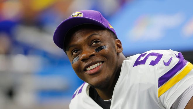 Minnesota Vikings quarterback Teddy Bridgewater smiles on the bench against the Detroit Lions during an NFL football game in Detroit, Thursday, Nov. 23, 2017. (AP Photo/Paul Sancya)