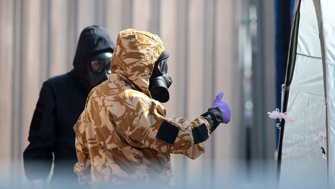 Emergency workers in protective suits search around John Baker House Sanctuary Supported Living after a major incident was declared when a man and woman were exposed to the Novichok nerve agent on July 6, 2018, in Salisbury, England.