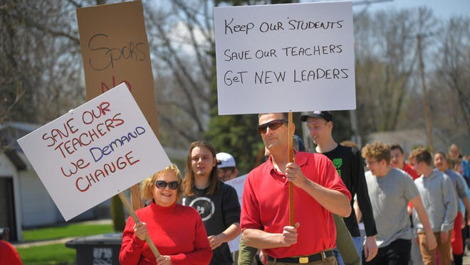 Student and parents march with protest signs against the school superintendent Friday afternoon, May 4, 2018 at Omro High School.