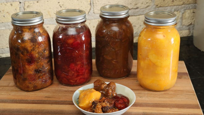 Home-canned pie fillings from left to right are vegetarian mincemeat, cherry, pecan, peach, with a bit of each in the dish.