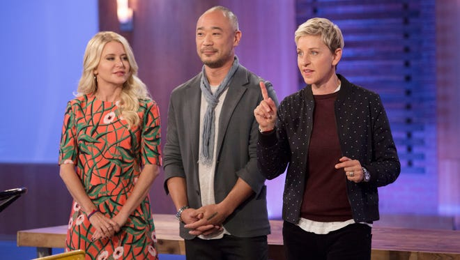 "This image released by HGTV shows  judges Christiane Lemieux, from left, and Cliff Fong with Ellen DeGeneres during the taping of ""Ellen's Design Challenge,"" returning for a second season on  at 9 p.m. EST on HGTV."