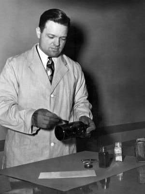 Claude A. Armour, Inspector with the Memphis Police Department and a graduate of the thirty-fifth session of the FBI National Academy, dusts for latent fingerprints in the FBI Laboratory in Washington, D.C. in this photograph from June 1947.