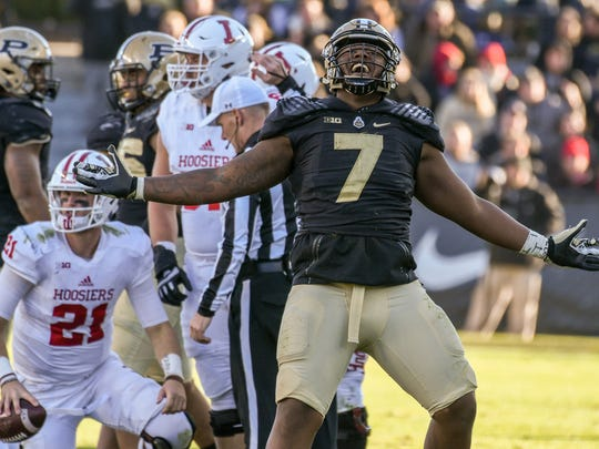Eddy Wilson of Purdue celebrates after sacking Indiana