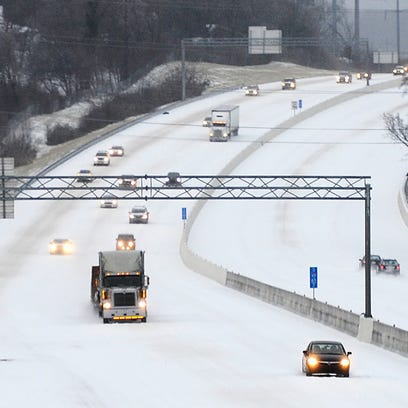 I-65 near Hwy 96 in Franklin is covered with snow on