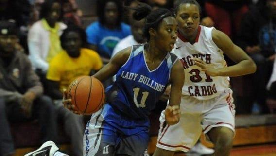 Kimberly Burton drives against North Caddo in a game last season.