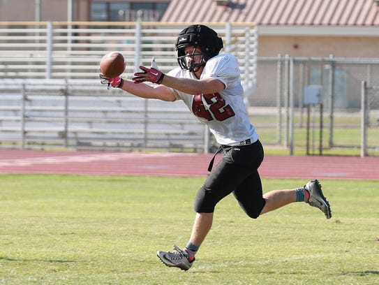 Mt. Whitney linebacker Jed Whetstone catches a pass