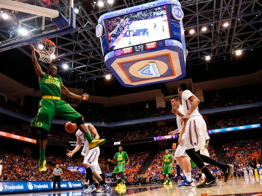 Oregon's Elgin Cook dunks during the second half of an NCAA college basketball game against Boise State in Boise, Idaho, on Saturday, Dec. 12, 2015. Boise State won 74-72.