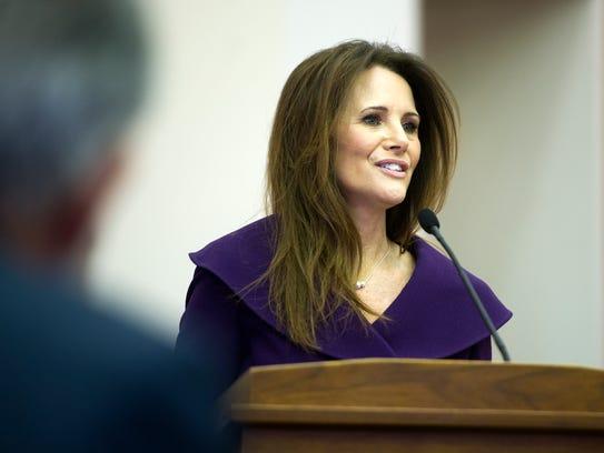 Debbie Poplin, clerk of the court speaks before the