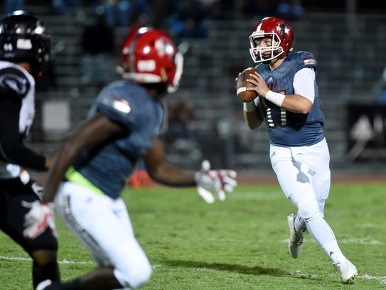 Vero Beach quarterback Nick Celidonio (right) has passed for 1,887 yards and 21 touchdowns this season to help the Fighting Indians reach the regional semifinals for the fourth year in a row.