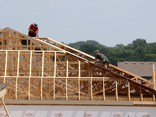 Workers construct a new home in the Rock Creek Crossing development in Ankeny in 2014. The city has grown rapidly over the past 10 years and was named the 10th-fastest growing city in the country by the U.S. Census Bureau on Thursday.