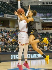 Kiah Gillespie of Maryland, plays stout defense against Chase Coley of Iowa, Big Ten Women's Basketball Tournament, Bankers Life Fieldhouse, Indianapolis, Friday, March 4, 2016.