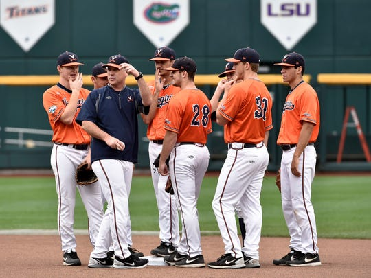 Virginia coach Brian O'Connor, second from left, talks to players, including pitcher Kevin Doherty (28) and outfielder Joe McCarthy (31), during practice at TD Ameritrade Park in Omaha, Neb., on Friday.