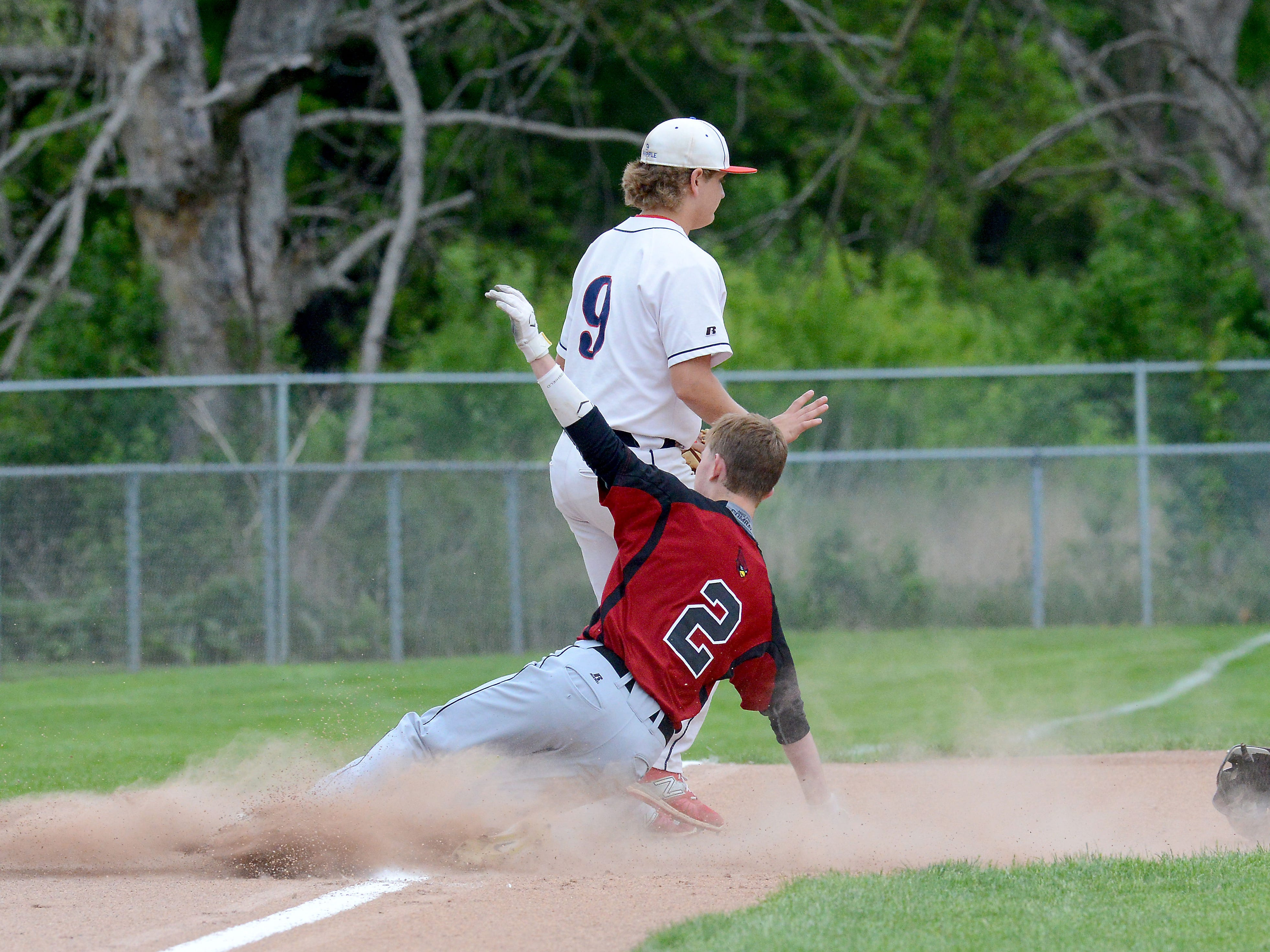 Portland's Haydin Brandt (2) slides safely into third base during the first inning of the Raiders' 3-2 loss to Mason in the Diamond Classic. Brandt would score later in the inning.