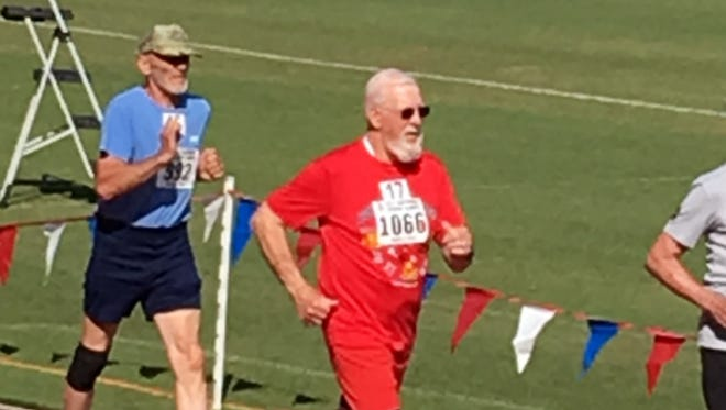 New Mexican athlete Vernon Dyer of Roswell (pictured wearing red),  has been competing in the Race Walk event  in the National Senior Games since 1990 and has ran a total of 35 marathons.