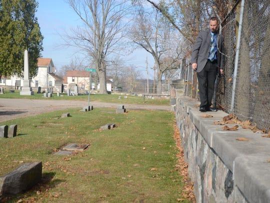 Battle Creek Detective Nick Woolman checks along a