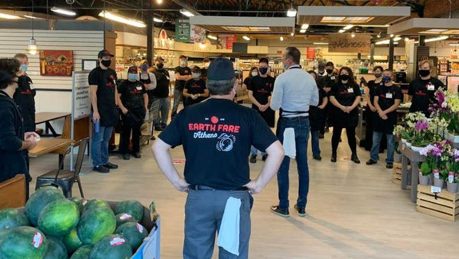 Employees gathered at Earth Fare in Athens on Wednesday as the grocery reopened under new ownership.
